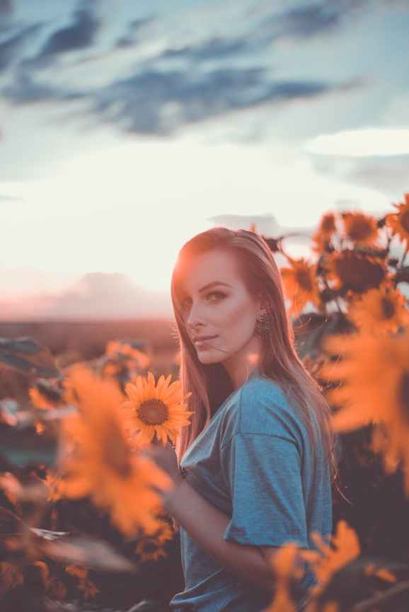 photo of standing near sunflowers